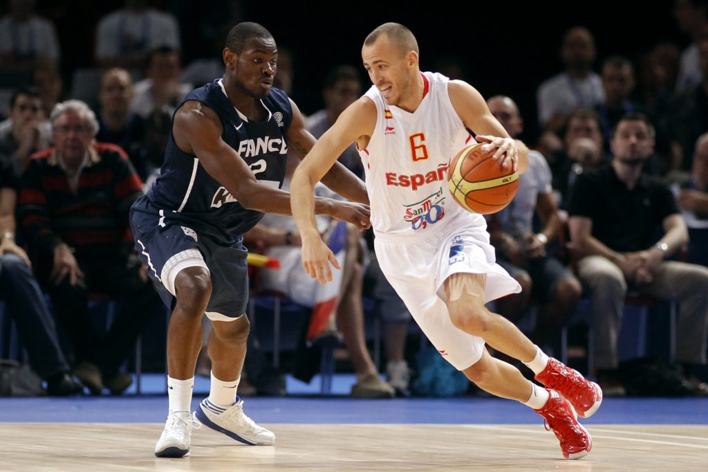 Rodriguez of Spain is guarded by France's Bokolo in the fourth quarter of their Olympics national teams' friendly match in Paris